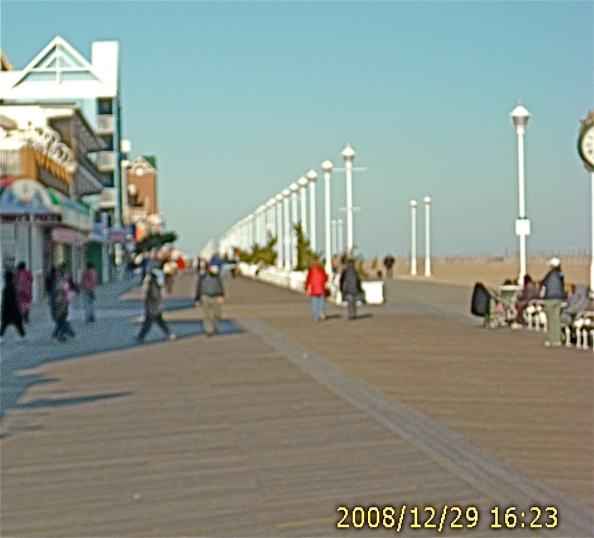 People enjoying the holiday week on the Ocean City Boardwalk, looking north from North Division Street.