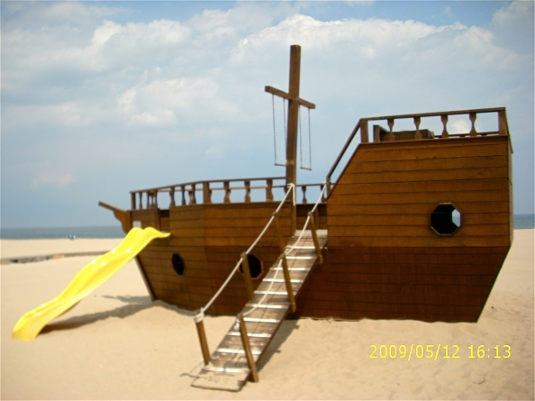 Wooden play ship is on the sand at Third Street in Ocean City, complete with slide, gangway and portholes.