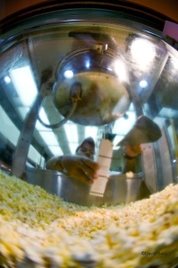 Some of the major food groups in Ocean City: Popcorn, Pizza, Ice Cream, and of course Crab cakes. In this outstanding photo, courtesy of Maryland photographer David Baus, a worker fills a customer's order for fresh popcorn at Fisher's Popcorn, a landmark family business on the Boardwalk.