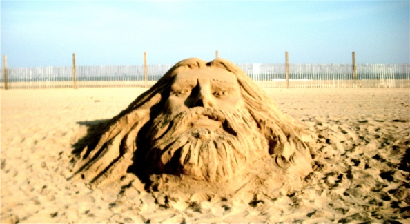 This sand art was created in May 2009, even before the winter snow fencing in the background was taken down.