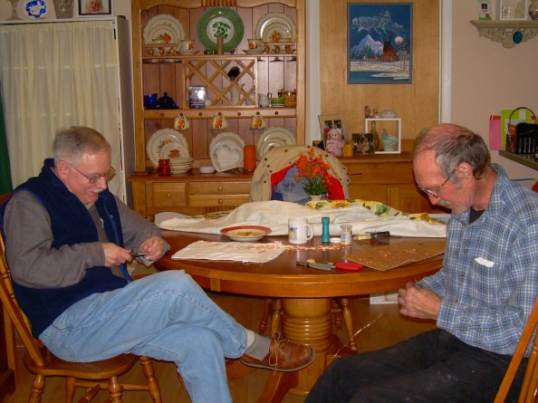 Bob Connor (right) and me practicing our fine-motor skills, using wire cutters to make small crosses out of copper wire. Photo by Judy Davis. The crosses are for a project for Judy's kindergarten class. Sixty crosses! Took us two nights. Can you handle this kind of excitement?