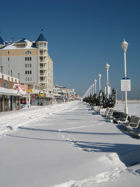 The Ocean City Boardwalk was snow-covered early Sunday morning, following Saturday's all-day snowstorm.