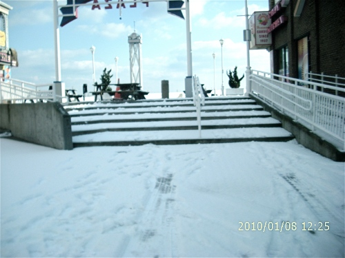 Snow-covered steps up to the Boardwalk from the Somerset Plaza.