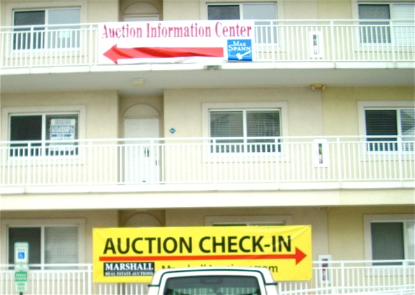 CONDOS WENT THATAWAY.  Signs with big red arrows urge you in opposite directions at Bahai Vista on Edgewater Avenue in Ocean City, MD.