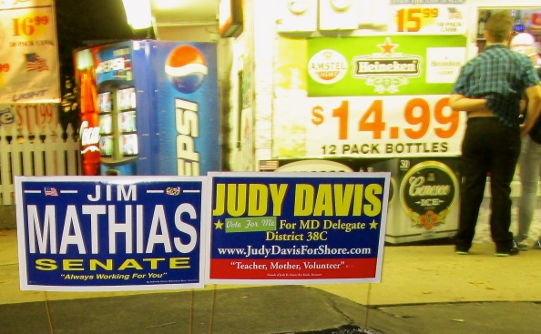 TWO SIGNS IN FRONT OF WEAVER'S BEER STORE AT THE ENTRANCE TO OCEAN CITY SUPPORT MR. WEAVER'S FAVORITE CANDIDATES, AND PROBABLY GIVE A FAIRLY ACCURATE IDEA OF WHICH WAY THE WIND'S BLOWING ON THE ISLAND.  (John Hayden photo)